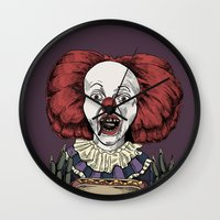 pennywise Wall Clocks featuring Pennywise is hungry by Andres Eladio
