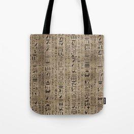 Egyptian hieroglyphs on wooden texture Tote Bag