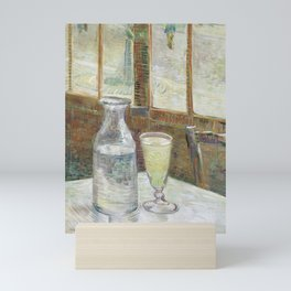 Café table with absinth Mini Art Print