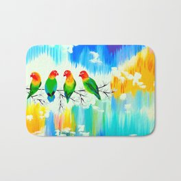 Lovebirds on a branch Bath Mat