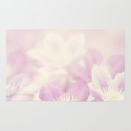 clematis flowers for background, soft focus Rug