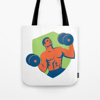 crossfit Tote Bags featuring Strongman Crossfit Lifting Dumbbells Shield Retro by patrimonio