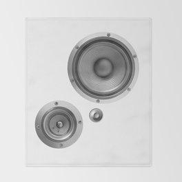 Subwoofer Speaker on white Throw Blanket