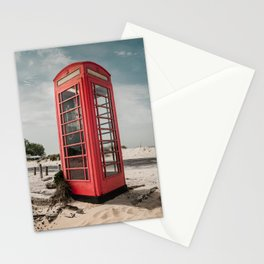 Vintage red telephone box on a sandy beach Stationery Cards