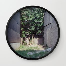 sunny down the middle Wall Clock