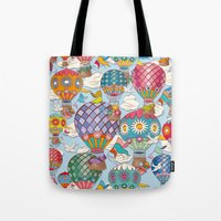 hot air balloon Tote Bags featuring Hot Air Balloon by Helene Michau