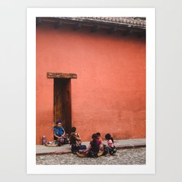 Guatemalan family in traditional dress sells jewellery and cloths on the street in Anitgua Guatemala Art Print