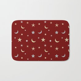 Gold and silver moon and star pattern on red background Bath Mat