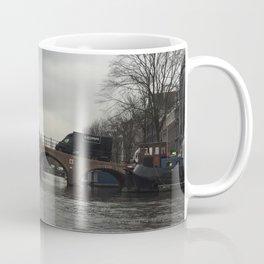 Amsterdam river bridge on a cloudy rainy day Coffee Mug