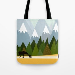 Woodland snowy mountain tops trees and mother moose and baby Tote Bag
