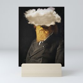 The inability of men with golden faces to be photographed without cloud. Mini Art Print