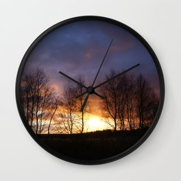 Trees at sunset Wall Clock