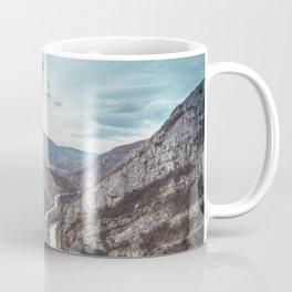 Tourist on the peak of high rocks. Big canyon on Balkan peninsula Coffee Mug
