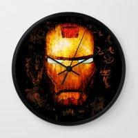 iron man Wall Clocks featuring Iron Man by Sirenphotos