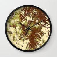 emerald Wall Clocks featuring Emerald by Alicia Bock