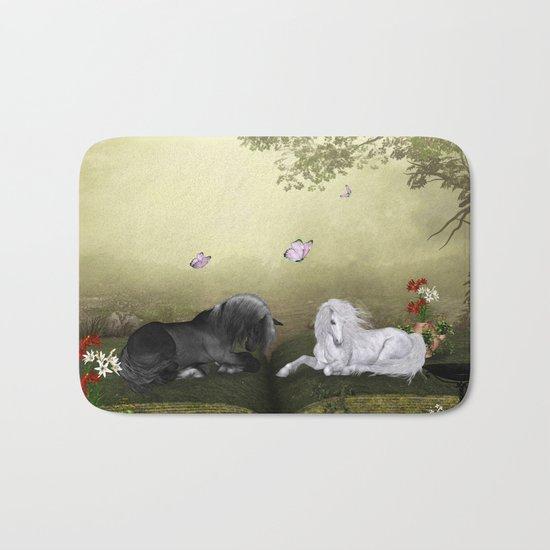 Wonderful white unicorn with black horse Bath Mat