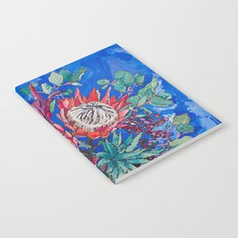Painterly Bouquet of Proteas in Greek Horse Urn on Blue Notebook