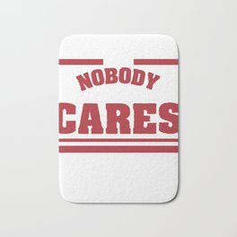 """""""Shhh Nobody Cares"""" tee design. Simple and attractive tee perfect for gifts to your loved ones!  Bath Mat"""