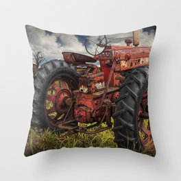 Abandoned Old Farmall Tractor in a Grassy Field on a Farm Throw Pillow