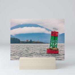 Sea lions relaxing on floating buoy in Auke Bay, Alaska Mini Art Print