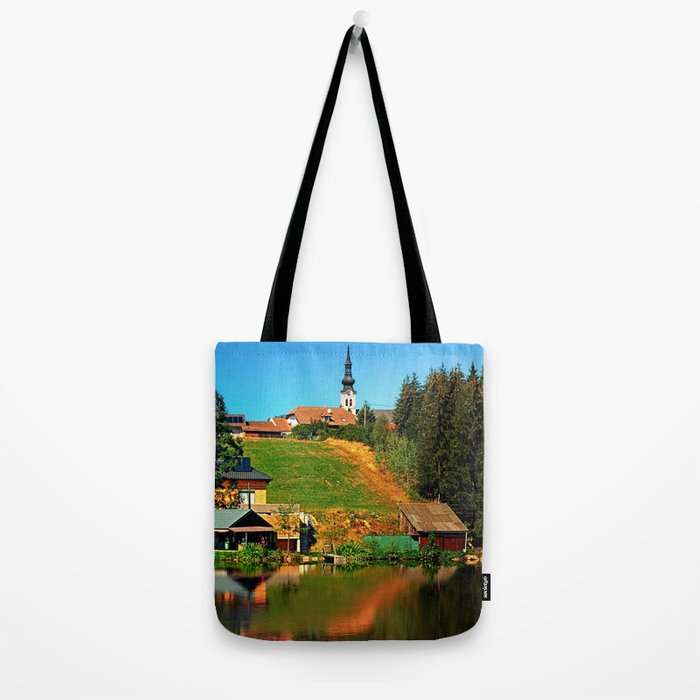 A village in the mirror Tote Bag