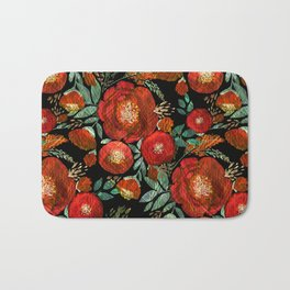 Red flowers on a black background. Bath Mat