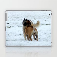 Dogs playing in the snow Laptop & iPad Skin