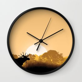Romantic moose is watching sunset Wall Clock