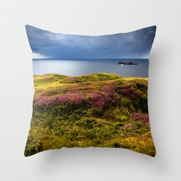 Coastline in France with dark clouds and a sailboat  Throw Pillow
