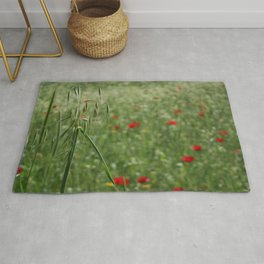 Seed Head With A Beautiful Blur of Poppies Background Rug