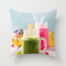 Close-up of green fresh smoothie with fruits, berries, oats and seeds, selective focus Throw Pillow