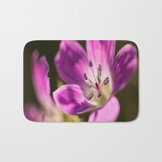 Purple glow in forest Bath Mat