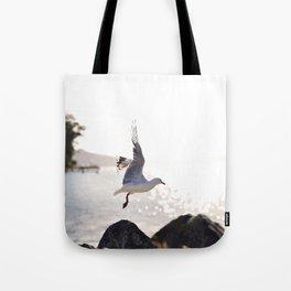 Seagull takes flight over Dunedin's MacAndrew Bay Tote Bag