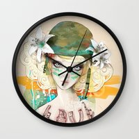 war Wall Clocks featuring War girl by Ariana Perez