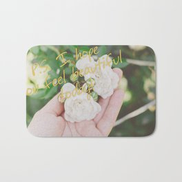 Motivation card on background of two white roses in female hand Bath Mat