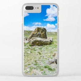 Tarkhatinsky megalithic complex. Steppe and blue mountains on the horizon. Altai Russia. Clear iPhone Case