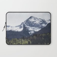 Winter and Spring - green trees and snowy mountains Laptop Sleeve