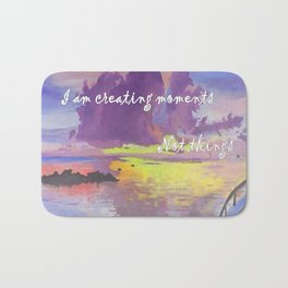 I am creating moments not things Bath Mat