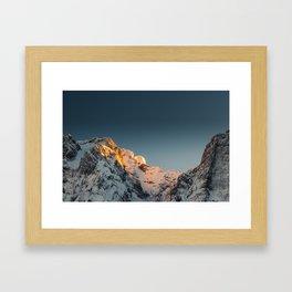 Last light before sunset on mountains Framed Art Print