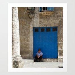Older gentleman sitting against blue doors Art Print