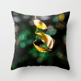 Yellow leaves in colorful bokeh Throw Pillow