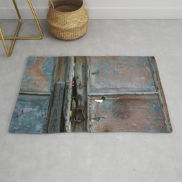 Rusty metal gate Rug