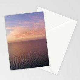 Aerial panoramic view of sunset over ocean. Nothing but sky, clouds and water. Beautiful serene scene Stationery Cards