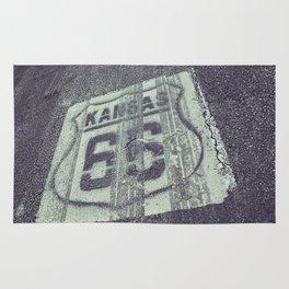Historic Route 66 marker in Kansas on asphalt. Rug