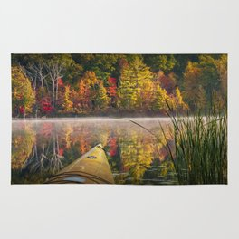 Kayaking on a Small Lake in Autumn Rug
