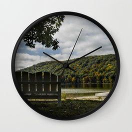 Bench in front of the lake during fall Wall Clock