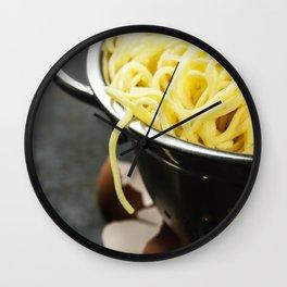 spaghetti in colander on dark vintage background Wall Clock