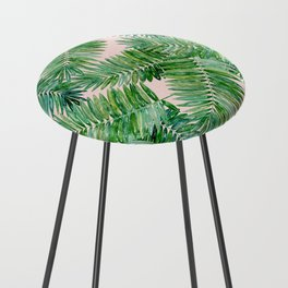 Green palm leaves on a light pink background. Counter Stool