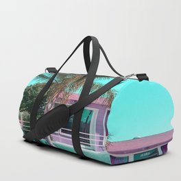 pink building in the city with palm tree and blue sky Duffle Bag
