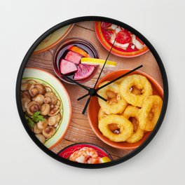 I - Assortment of Spanish tapas and sangria on a rustic table Wall Clock
